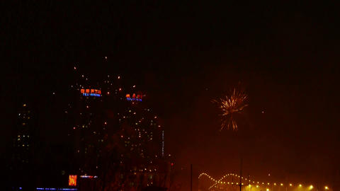 Fireworks over city building at night,bridge,viaduct,street-light Footage