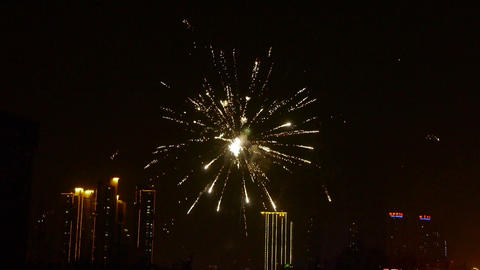 Fireworks over city building at night Stock Video Footage