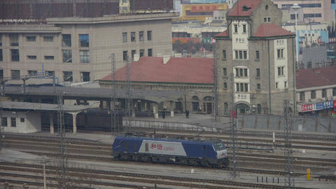 Locomotive traveling through railway station of Tai'an in... Stock Video Footage