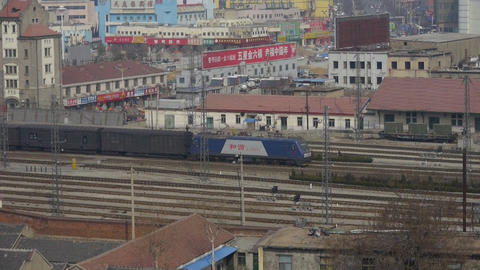 Long goods train traveling on railway at Taian City near... Stock Video Footage