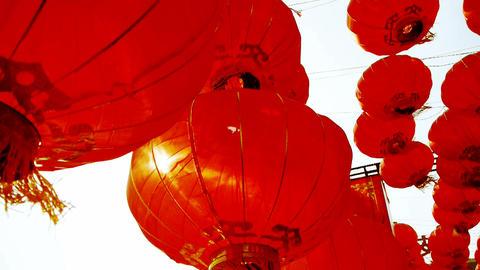 Red lanterns tassel swaying in wind,behind sun,elements... Stock Video Footage