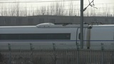 White high-speed train between the wire Footage