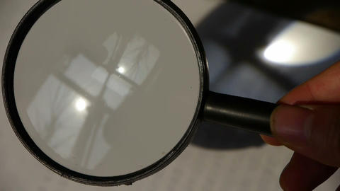 Focus of magnifying glass,In hand Stock Video Footage