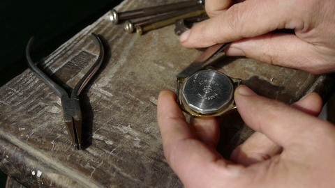 Fasten watch lid on wood desk,A lot of tools Stock Video Footage
