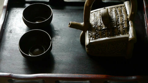 Teapot pouring tea,ancient customs of leisure.china,japan Stock Video Footage