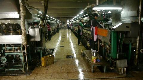 Workers reeling at workshop.Silkworm cocoon at silk factory Stock Video Footage