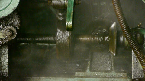 Complex precision machines in operation.Bearing,Axis,pipeline,tube,Oil spill Footage
