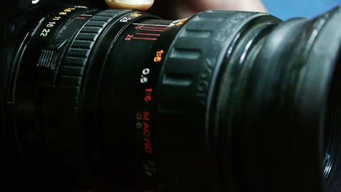 Manually adjust camera lens Stock Video Footage