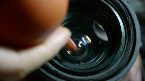 Manually clean camera lens Stock Video Footage