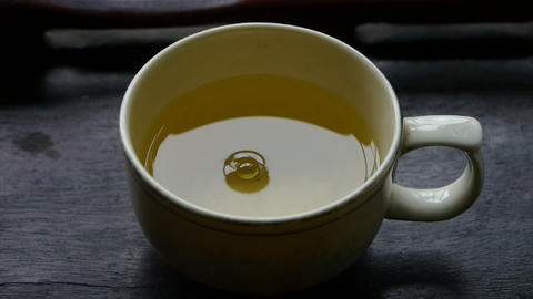 A bowl of steaming tea.china,water Stock Video Footage
