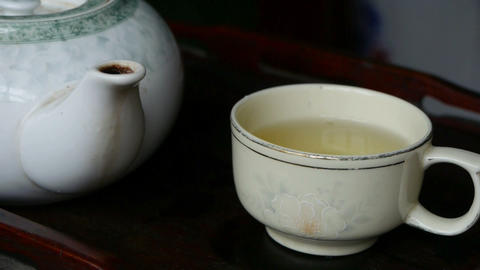 Teapot pouring tea,ancient customs of leisure.china,japan,water Footage