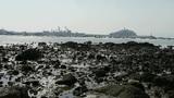 Tsingtao trestle.Island of QingDao city.Warship moored in port,reef Footage