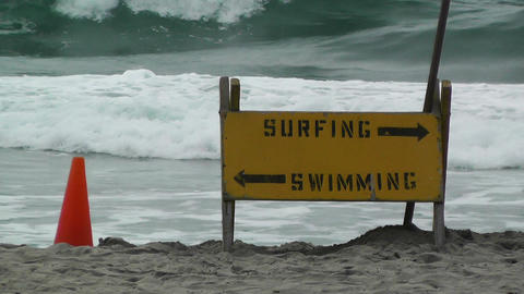 Surfing Swimming signs on Beach Stock Video Footage
