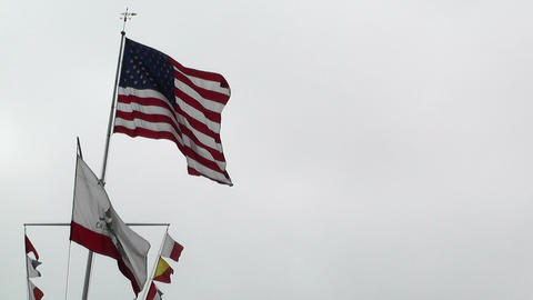 USA and California flag in strong wind 60 fps native... Stock Video Footage