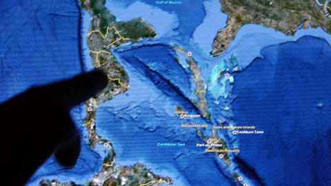touch globe gps map on ipad,drag to sea and mainland Stock Video Footage