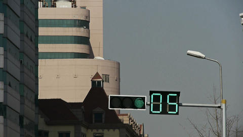 Traffic lights on road,city's buildings Stock Video Footage