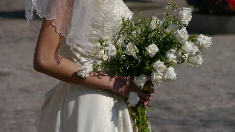 Bride carrying a bouquet of flowers Stock Video Footage