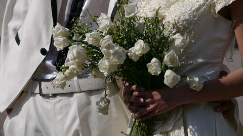Groom and bride together,Bride carrying a bouquet of flowers Stock Video Footage