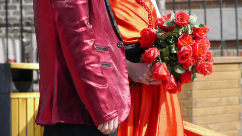 Groom and bride together,Bride wearing a red wedding dress,carrying a bouquet of Footage