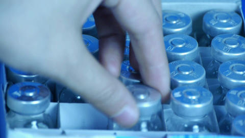 Removed injection bottle from box Stock Video Footage