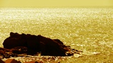 Sparkling water surface and rock reef coastal,horizon,skyline,sunrise,Gold Footage