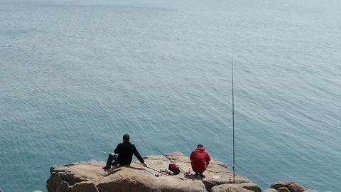 Man fishing on reef Stock Video Footage