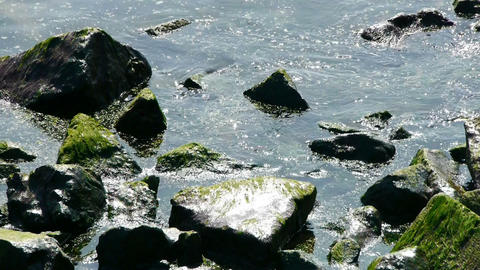 Ocean water surface and rock reef... Stock Video Footage