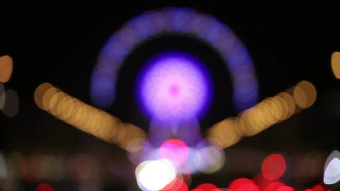Blurry view on Ferris Wheel in Paris, France by Night Live Action