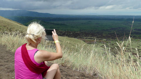 Blond Woman Taking Picture With Mobile Of Landscape Masaya stock footage