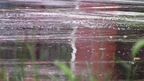 Car traffic in little city on heavy rain 14 Footage