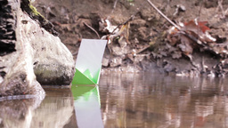 Green paper boat floating on water among thousands of midges 92a Footage