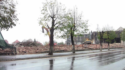 Machinery working on the demolition of buildings near a frequented road 07 Footage