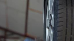 Auto mechanic loosen the a wheel 28 Footage