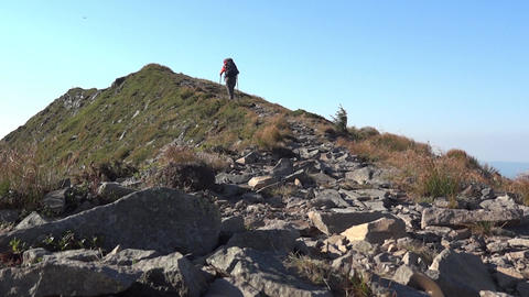 Excursionist who climbs on an upward path on mountainside 22c Footage
