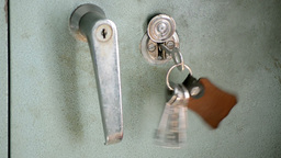 Hand-Held Luggage Locker With Key Hanging Footage