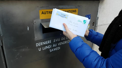 Woman Putting Letters In Mailbox Footage