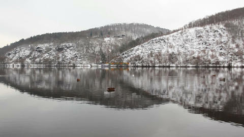Symmetry winter landscape and yellow train near the Vltava river Live Action