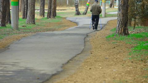 Elderly man exercising in park Footage
