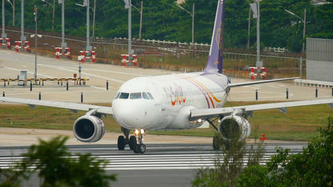 Airbus 320 taxiing before departure from Phuket airport Footage