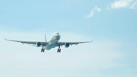 Passenger airliner approaching in sky with gear landing Footage