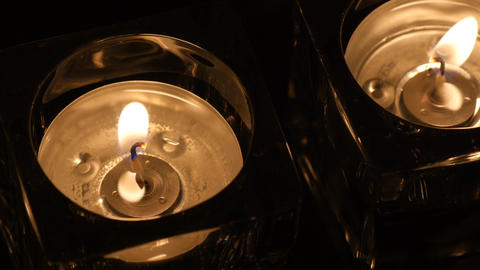 Close up two tealights in holder evening Footage