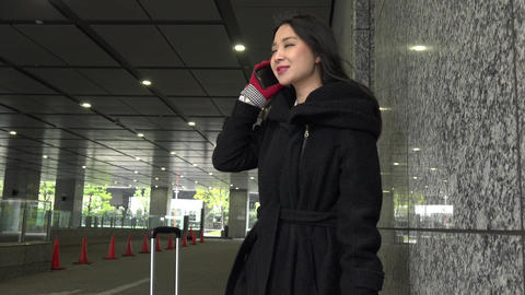 Winter Season Cold Weather With Asian Businesswoman On The Phone Live Action