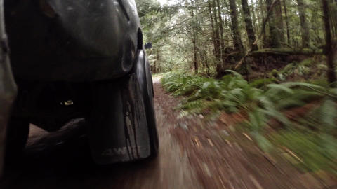 Truck driving down dirt road - low angle Footage