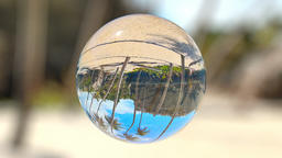 Beautiful Tropical Landscape seen through a Glass Orb, seamless loop Animation
