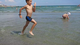 Little boy running on the beach, Constanta, Romania, slow motion Footage