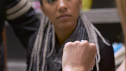 Hand held pushin of an attractive multi-ethnic woman listening and talking at a  Footage