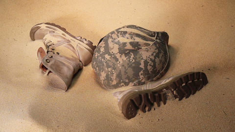 Soldier hat boots and sand glass- Footage