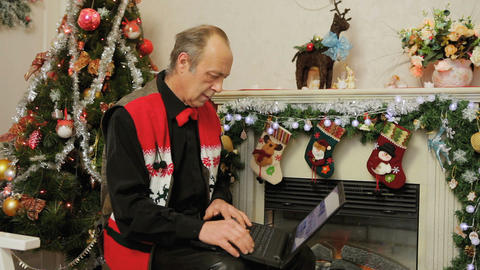 Man Using Laptop. Christmas Decorations Footage