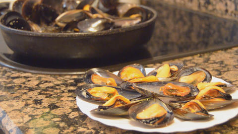 Mussels On A Plate Served From Pan Live Action