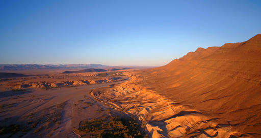 Aerial, Flying Over Palm Oasis Along Mountains At Tissint, Morocco Footage